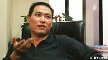 Chinese lawyer Pu Zhiqiang answers a question during an interview in his office in Beijing on this October 20, 2004 file photo. China has detained the prominent human rights lawyer on a charge of causing a disturbance, two lawyers said on May 6, 2014, after Pu attended a weekend meeting that urged a probe of the bloody suppression of pro-democracy protests in Tiananmen Square in 1989. REUTERS/Benjamin Kang Lim/Files (CHINA - Tags: CRIME LAW POLITICS)