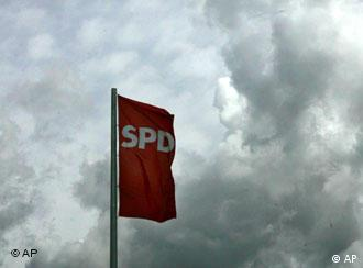 The SPD flag amid a background of dark clouds