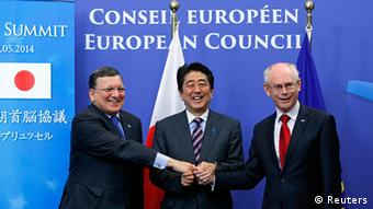 Japanese Prime Minister Shinzo Abe is welcomed by European Commission President Jose Manuel Barroso and European Council President Herman Van Rompuy ahead of a EU-Japan Summit in Brussels May 7, 2014.