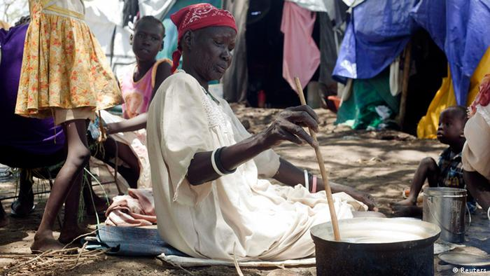 A woman prepares a meal at the Bor camp. Photo: REUTERS/Carl Odera