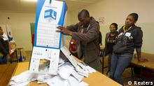 Election officials empty ballot boxes as counting begins at a voting station in Embo, west of Durban, May 7, 2014. REUTERS/Rogan Ward (SOUTH AFRICA - Tags: POLITICS ELECTIONS)