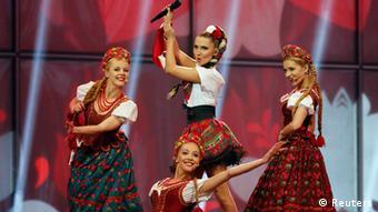 Four women on stage during Poland's Eurovision performance