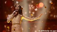 Conchita Wurst representing Austria performs the song Rise Like A Phoenix after winning the Eurovision Song Contest 2014 Grand Final in Copenhagen, Denmark, on May 10, 2014. AFP PHOTO/JONATHAN NACKSTRAND (Photo credit should read JONATHAN NACKSTRAND/AFP/Getty Images)