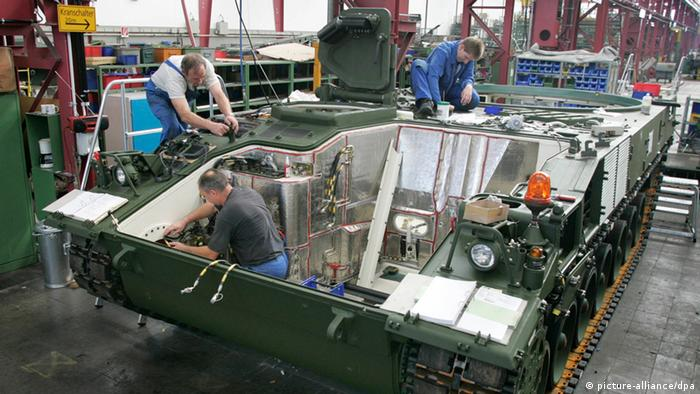 Workers maintain the new PzH 2000 Howitzer artillery system tank at Rheinmetall at Rheinmetall Defence in Kassel.