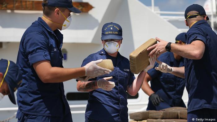 U.S. Coast Guard crew members off load blocks of seized marijuana, Miami Beach