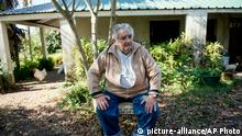 Uruguay's President Jose Mujica sits outside his home during an interview on the outskirts of Montevideo, Uruguay, Friday, May 2, 2014. Mujica said Friday that his country¿s legal marijuana market will be much better than Colorado¿s, where he says the rules are based on ¿fiction¿ and ¿hypocrisy¿ because the state loses track of the drug once it¿s sold and many people fake illnesses to get prescription weed. Mujica says this won¿t be allowed in Uruguay, where the licensed and regulated market will be much less permissive with drug users. (AP Photo/Matilde Campodonico)