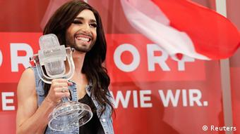 Eurovision Song Contest 2014 Conchita Wurst holds the crystal microphone award