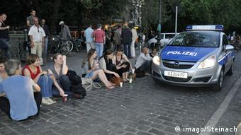 Young people on the street and a police car