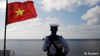 A Vietnamese naval soldier stands quard at Thuyen Chai island in the Spratly archipelago in this January 17, 2013 file picture.