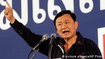 Thai Prime Minister Thaksin Shinawatra make a point as he addresses the crowd during a major rally near the Thai Grand Palace, Friday, Feb. 4, 2005, in Bangkok, Thailand.
