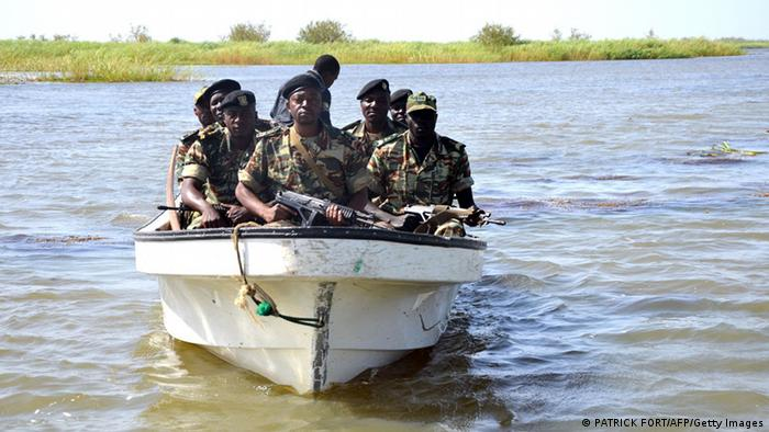Soldiers inside a patrol boat in Lake Chad.