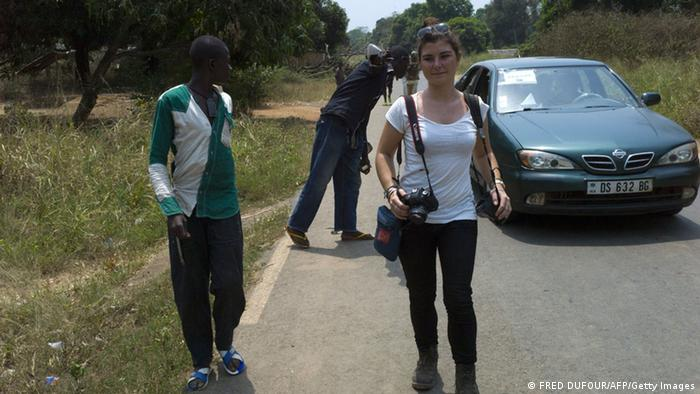 French journalist Camille Lepage, 26, has been killed while on a reporting assignment in Central African Republic, French President Francois Hollande said on May 13, 2014 in a statement, vowing to make every effort to shed light on the murder. 'The body of Miss Lepage was found by a patrol of Sangaris troops while checking a vehicle driven by anti-Balaka militia in the region of Bouar' in west of the country, it said, referring to militamen from the mainly Christian vigilante group. (Photo: FRED DUFOUR/AFP/Getty Images)