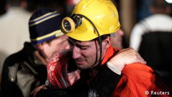 miner hugs relative. (Photo: REUTERS/Osman Orsal)