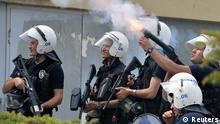 Riot police fire tear gas against protesters as they demonstrate to blame the ruling AK Party (AKP) government on the mining disaster in western Turkey, in Ankara May 14, 2014. Rescuers pulled more dead and injured from a coal mine in western Turkey on Wednesday more than 19 hours after an explosion, bringing the death toll to above 200 in what could become the nation's worst ever mining disaster.Hundreds more were still believed to be trapped in the mine in Soma, about 480 kilometres (298 miles) southwest of Istanbul. The explosion, which triggered a fire, occurred shortly after 3 pm (1200 GMT) on Tuesday. REUTERS/Stringer (TURKEY - Tags: DISASTER ENERGY CIVIL UNREST CRIME LAW)