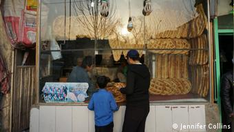 Kids peering at huge slabs of naan bread