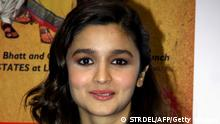 Indian Bollywood actress Alia Bhatt poses during the launch of Indian author Chetan Bhagat's new book '2 States' in Mumbai on April 7, 2014. AFP PHOTO/STR (Photo credit should read STRDEL/AFP/Getty Images)
