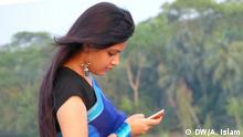 Title: Bangladeshi girl using Smartphone Description: A Bangladeshi girl in shari using Smartphone during a walk on a bridge of Bagerhat. More than 70 million people in Bangladesh use mobile phone regularly. Demand of Smartphone is growing rapidly in the country as internet is available easily via mobile network. Many people use Facebook in Bangladesh via mobile internet. Declaration: I (Arafatul Islam) have taken this photo on 26.05.2014 during my visit to Bangladesh.