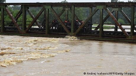 Rescue efforts on a bridge over a flooded river near the town of Lazarevac, 45 kilometers south of Belgrade.