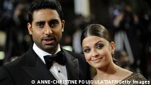 Indian model Aishwarya Rai and husband Abhishek Bachchan arrive for the screening of Outrage presented in competition at the 63rd Cannes Film Festival on May 17, 2010 in Cannes. AFP PHOTO / ANNE-CHRISTINE POUJOULAT (Photo credit should read ANNE-CHRISTINE POUJOULAT/AFP/Getty Images)