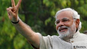 Narendra Modi - Hindu nationalist Narendra Modi, the prime ministerial candidate for India's main opposition Bharatiya Janata Party (BJP), gestures during a public meeting in Vadodra, in the western Indian state of Gujarat May 16, 2014.