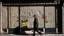 A man walks down a street of Bairro Alto, one of Lisbon's typical neighbourhoods, on February 25, 2013. AFP PHOTO / PATRICIA DE MELO MOREIRA (Photo credit should read PATRICIA DE MELO MOREIRA/AFP/Getty Images)