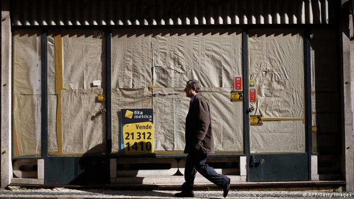 A man walks past a closed business in Bairro Alto, Lisbon (Photo: PATRICIA DE MELO MOREIRA/AFP/Getty Images)