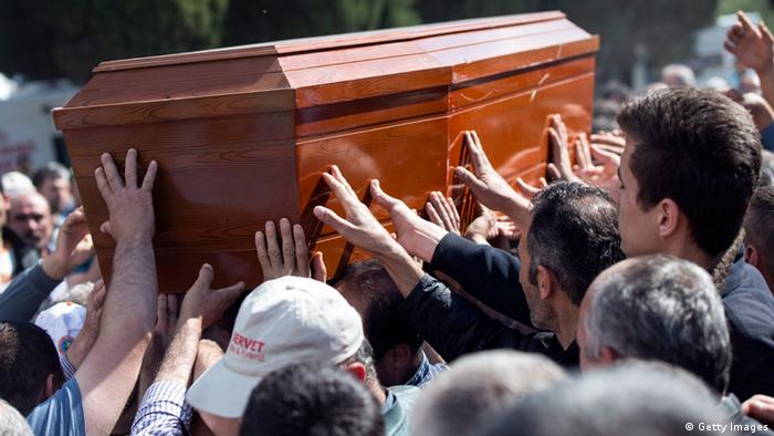 Relatives carry a coffin containing one of the victims of the Soma mining disaster