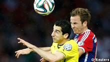 Bayern Munich's Mario Goetze (R) jumps for the ball with Borussia Dortmund's Henrikh Mkhitaryan during their German Cup (DFB Pokal) final soccer match in Berlin May 17, 2014. REUTERS/Tobias Schwarz (GERMANY - Tags: SPORT SOCCER) DFB RULES PROHIBIT USE IN MMS SERVICES VIA HANDHELD DEVICES UNTIL TWO HOURS AFTER A MATCH AND ANY USAGE ON INTERNET OR ONLINE MEDIA SIMULATING VIDEO FOOTAGE DURING THE MATCH.
