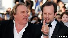 Actor Gerard Depardieu (L) and director Frederic Auburtin (R) pose on the red carpet for the screening of the film United Passions at the 67th Cannes Film Festival in Cannes May 18, 2014. REUTERS/Regis Duvignau (FRANCE - Tags: ENTERTAINMENT)