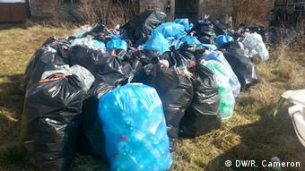 A picture of the plastic bottles that Jakub and Honza will use to build their boat. The bottles are in blue sacks and have been collected from the town.