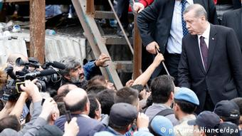 Erdogan visits Soma, Turkey, the site of a mining disaster.