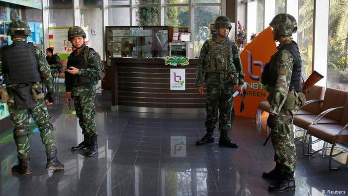 Troops in the lobby of the National Broadcasting Services building in Thailand