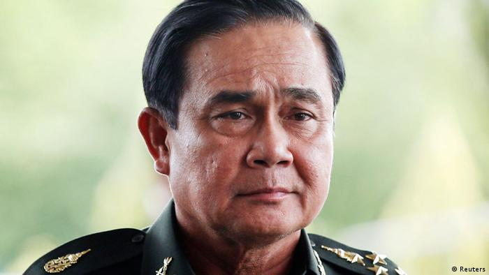 Thai Army chief General Prayuth Chan-ocha arrives to give a news conference at the Army Club in Bangkok May 20, 2014. Thailand's army declared martial law nationwide on Tuesday to restore order after six months of street protests that have left the country without a proper functioning government, but denied that the surprise move amounted to a military coup. REUTERS/Athit Perawongmetha