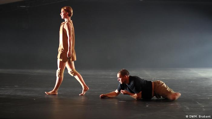 Martin, one of the veterans crawls along the stage once both his prosthetic limbs have been removed, he follows one of the ballerinas in the project.