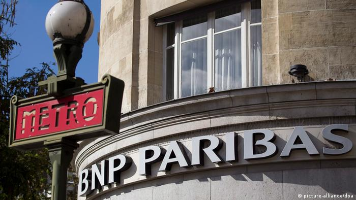 BNP Paribas Bank in Paris - epa04186283 (FILE) A file photo dated 14 September 2011 showing a general view of the logo outside a branch of French bank BNP Paribas, Paris. France's biggest bank BNP Paribas risks a fine 'far in excess' of 1.1 billion dollars for a possible breach of US sanctions, the group said 30 April 2014. Presenting its first-quarter results, BNP said there was 'a high degree of uncertainty' around the amount of the fine it faced in the US over dollar payments to countries such as Iran, Sudan and Cuba that are subject to US sanctions. 'There is the possibility that the amount of the fines could be far in excess of the amount of the provision (of 1.1 billion dollars made in the fourth quarter of 2013),' the bank said. EPA/IAN LANGSDON +++(c) dpa - Bildfunk+++