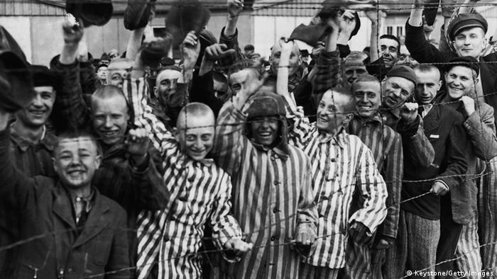 Young prisoners interned at Dachau concentration camp cheer the American troops who liberated the camp (Keystone/Getty Images)