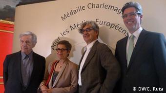 Der französische Regisseur Constantin Costa-Gavras (l.) mit Marion Döring, Wim Wenders und Marcel Philipp (Foto: DW/Christina Ruta)