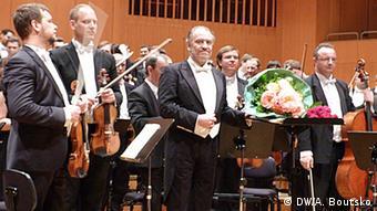 Gergiev und das Petersburger Mariinski-Orchester bei einem Auftritt in München, 22.5. 2014. (Foto: DW/A. Boutsko)
