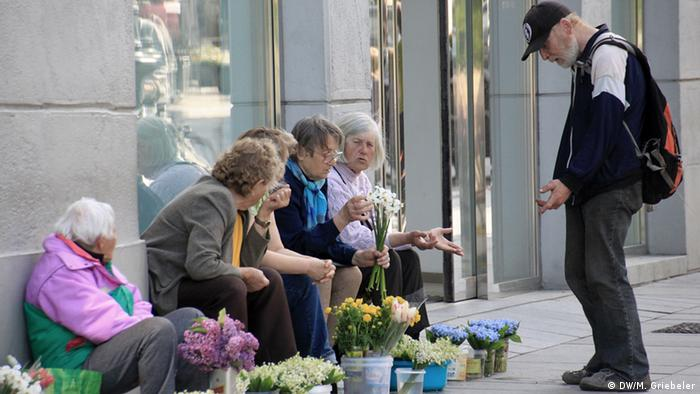 Pensioners selling flowers in the streets of Vilius, Lithuania