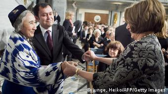 Leader of the Democrats in the US House of Representatives Nancy Pelosi (R) greets exiled Uyghur leader Rebiya Kadeer (L) and Alim Seytoff (2-L) , vice president of the Uyghur American Association (UAA) before the Nobel Peace Prize ceremony at Oslo City Hall on December 10, 2010.