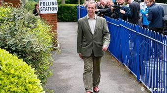 Nigel Farage walks outside.