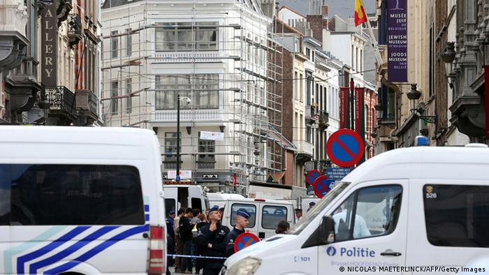 Policemen close the access of the scene of a shooting near the Jewish Museum in Brussels, on May 24, 2014. Photo credit should read NICOLAS MAETERLINCK/AFP/Getty Images)