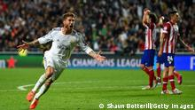 LISBON, PORTUGAL - MAY 24: Sergio Ramos of Real Madrid celebrates scoring their first goal in stoppage time during the UEFA Champions League Final between Real Madrid and Atletico de Madrid at Estadio da Luz on May 24, 2014 in Lisbon, Portugal. (Photo by Shaun Botterill/Getty Images)