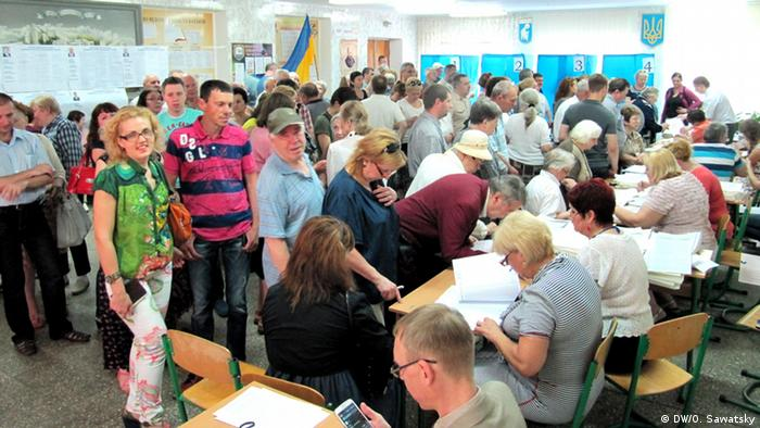Voters waiting to place their votes in Kyiv