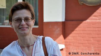 Irina, a Kyiv housewife, wearing a White blouse with red embroidery outside a polling station