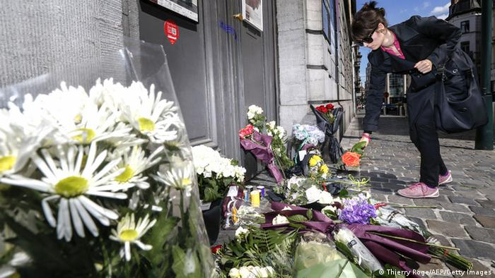 A woman lays a flower on the pavement in front of the Jewish Museum of Brussels on May 25, 2014 where an attack by a probable lone gunman the day before killed two Israelis and a French woman. AFP PHOTO / BELGA / THIERRY ROGE THIERRY ROGE/AFP/Getty Images)