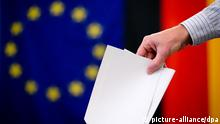 German Chancellor Angela Merkel gestures after voting in the European Parliament election at a polling station in Berlin, May 25, 2014. Germany, France, Spain, Italy and Poland are among the major EU member states voting on Sunday, representing the bulk of the 388 million Europeans eligible to cast ballots and elect the 751 deputies to sit in the European Parliament from 2014-2019. REUTERS/Thomas Peter (GERMANY - Tags: POLITICS ELECTIONS TPX IMAGES OF THE DAY