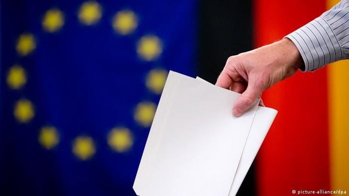 Symbol photo of a person casting a ballot with an EU and a German flag in the background