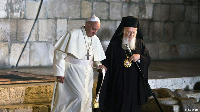 Ecumenical Patriarch of Constantinople Bartholomew (R) with Pope Francis as they meet outside the Church of the Holy Sepulchre in Jerusalem's Old City May 25, 2014. REUTERS/Nir Elias