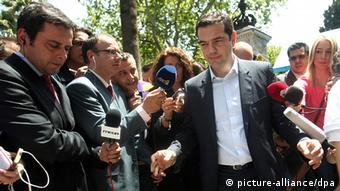 Alexis Tsipras walking through a crowd